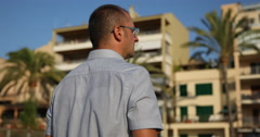 Man Looking Searching for Friend Waiting Someone Exotic Location Palm Trees Day Stock Footage