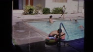 1966: young kids swimming and playing in the swimming pool on a sunny day Stock Footage