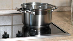 Pot Boiling On The Stove Stock Footage