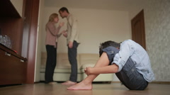 Boy is present at a quarrel parents. father beat her mother. stress in a child Stock Footage
