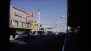 1966: a large hotel with white letters in the city on a busy street CATALINA Stock Footage