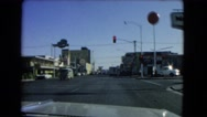 1966: approaching and stopping at a red light in a vehicle CATALINA, CALIFORNIA Stock Footage