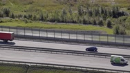 Aerial view to forest and car driving on the highway Stock Footage