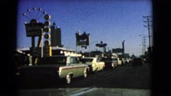 1966: people coming to enjoy rides and entertainment  Stock Footage