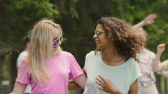 Energetic female couple dancing, smiling for camera, enjoying picnic in park Stock Footage