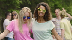Two sexy females dancing, shaking hips, smiling for camera, having fun at party Stock Footage