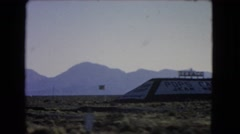 1966: traveling on road through flat landscape bordered by mountains. CATALINA Stock Footage