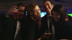 Friends in a nightclub taking selfies with a cell phone Stock Footage