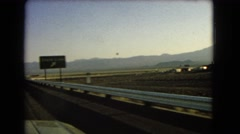 1966: a flat, barren, desolate landscape as seen from a moving vehicle CATALINA Stock Footage
