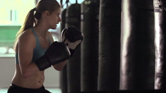 Woman does Muay Thai kickboxing training at the gym. Stock Footage