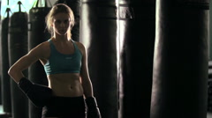 Portrait of a woman before doing Muay Thai kickboxing training at the gym. Stock Footage