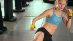 Woman doing Muay Thai kickboxing training at the gym. Stock Footage