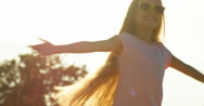Portrait girl child 7-8 years in sunglasses spinning on fountain background Stock Footage