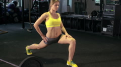A woman stretching at the gym. Stock Footage