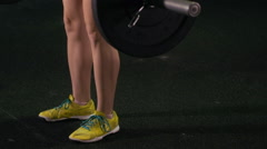 A woman doing deadlift weightlifting at the gym. Stock Footage