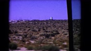 1966: journey beside a vast barren land edged by an industrial area CATALINA Stock Footage