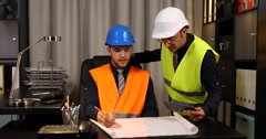 Constructor Engineer Men Talking Interior Office Collaboration and Cooperation Stock Footage