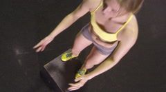 A woman doing box jumps at the gym. Stock Footage
