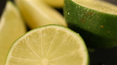 Juicy lime halves turning on plate, bartender preparing mojito cocktail closeup Stock Footage