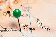 Tres Esquinas pinned on a map of Colombia Stock Photos