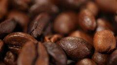Aromatic roasted coffee beans lying on sack, energy boosting morning drink Stock Footage