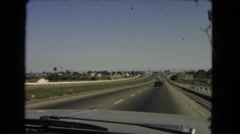 1966: a wide highway with a few number of cars going over the horizon  Stock Footage