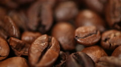 Roasted coffee beans rotating on stand, aromatic invigorating drink production Stock Footage