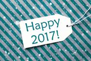 Label On Turquoise Paper, Snowflakes, Text Happy 2017 Stock Photos