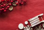 Christmas Decoration Like Sled On Red Wrapping Paper, Copy Space Stock Photos