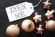 Bronze Tree Balls, Joyeux Noel Means Merry Christmas Stock Photos