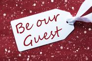 One Label On Red Background, Snowflakes, Text Be Our Guest Stock Photos
