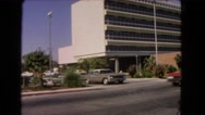 1966: driver waits for car to pass before pulling out of parking lot Stock Footage