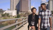 African American couple holding hands and taking a walk Stock Footage