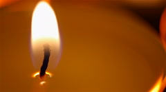Beautiful burning candle close-up, fire goes out, romantic atmosphere on date Stock Footage