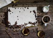 Map of the world, coffee beans on old paper. Eurasia, America, Australia, Africa Stock Photos
