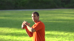 A father teaching his sons how to play American football. Stock Footage
