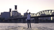 Man Takes A Selfie At The End Of A Dock With Beautiful View Of City Behind Him Stock Footage