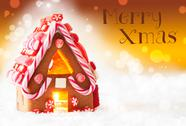 Gingerbread House, Golden Background, Text Merry Xmas Stock Photos