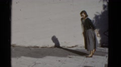 1952: a well dressed beautiful woman walking up a steep sidewalk SAN FRANCISCO Stock Footage
