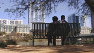 African American couple sitting together on a bench Stock Footage