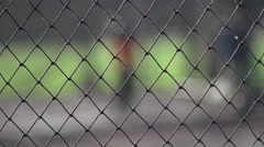 A young boy practicing baseball at the batting cages. Stock Footage