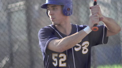 A young man practicing baseball at the batting cages. Stock Footage