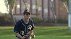 A young man playing catch with a baseball. Stock Footage