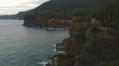 Wild steep cliffs along coastline in Port Arthur, Tasmania Stock Footage