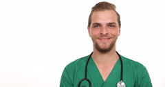 Attractive Optimistic Medical Doctor Man Smiling Looking Camera Hospital Office Stock Footage