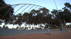 A baseball player practicing his swing. Stock Footage