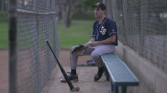 A baseball player resting on the bench. Stock Footage