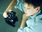 Laboratory. a boy and microscope. close-up. top view Stock Photos