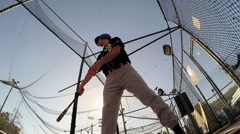 POV of a baseball player practicing at the batting cages. Stock Footage