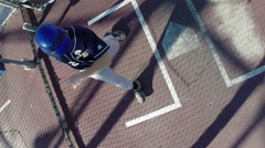 A baseball player practicing at the batting cages. Stock Footage